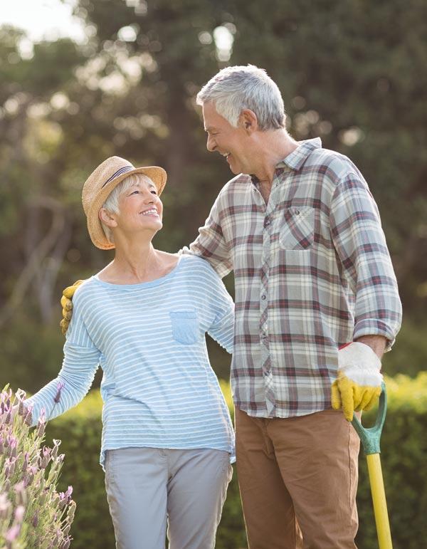 Couple enjoying gardening during retirement